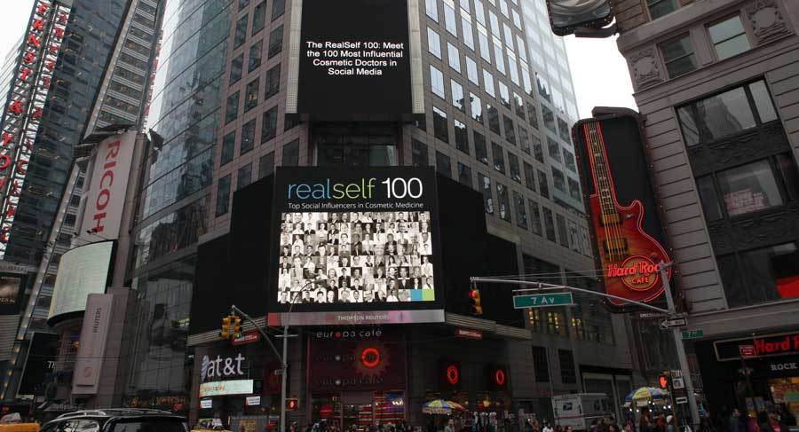 Aurora Clinics: Adrian Richards appears on RealSelf's Times Square billboard